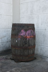 Recycled rum barrels are used as their trash cans