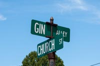 "Gin Street was originally mentioned in the boundary description in 1848, ""thence south to the west end of Gin Alley"""