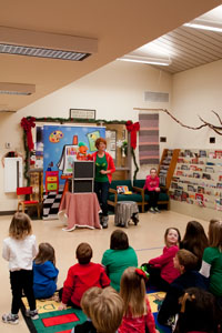Shawn entertains the children at the library with a book reading, puppet show, and inspirational messages