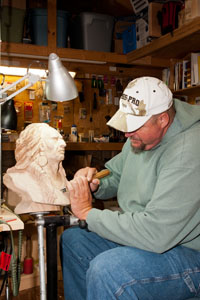 Woodcarving Studio's David Sharp working with his current sculpture