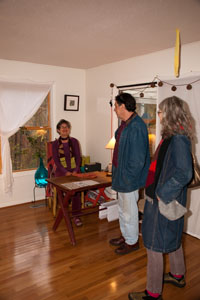 Jeanne Brady visits with guest in her home