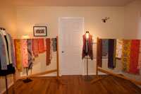 Jeanne offers her colorful hand painted scarves